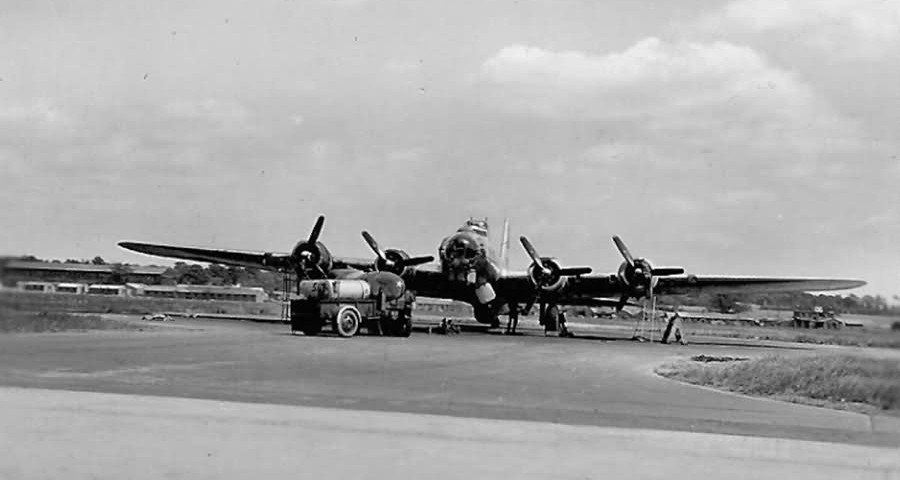 Tanker_Truck_Refueling_B-17_Bomber_Parked_on_Airfield
