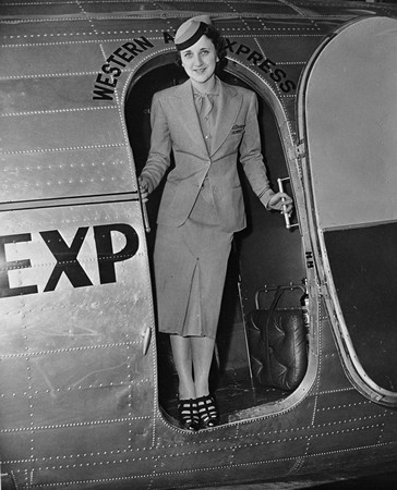 Elythe Loge standing in doorway of Douglas DC-3. Negative #WAL 12077. Job #7-20-11